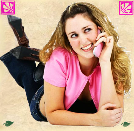 Smiling woman chatting on a pink telephone