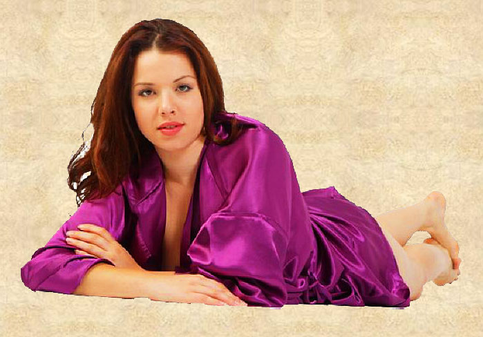 Young semi nude woman in a purple robe